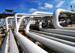 Heat resistant paint on long pipes in white